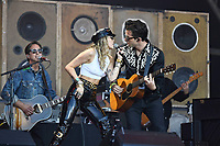 SHEPTON MALLET, ENGLAND - JUNE 30: Miley Cyrus and Mark Ronson performing at Glastonbury Festival, Worthy Farm, Pilton, on June 30, 2019 in Shepton Mallet, England.<br /> CAP/MAR<br /> ©MAR/Capital Pictures