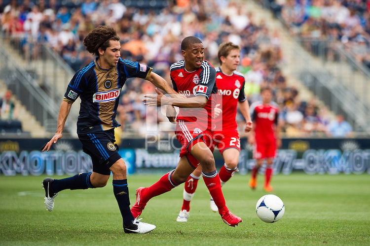 Reggie Lambe (19) of Toronto FC is marked by Gabriel Farfan (15) of the Philadelphia Union. The Philadelphia Union defeated Toronto FC 3-0 during a Major League Soccer (MLS) match at PPL Park in Chester, PA, on July 8, 2012.