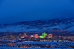 Downtown Reno night time cityscape with snow on the ground