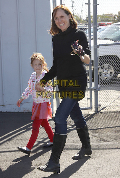 STELLA SHANNON CHESNUT & MOLLY SHANNON .P.S. Arts Express Yourself 2009 held At Moca, Santa Monica, California, USA, .15th November 2009..full length holding hands mother daughter family child kid black  knee high boots jeans .CAP/ADM/KB.©Kevan Brooks/AdMedia/Capital Pictures.