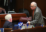 Nevada Assembly Republicans John Hambrick, left, and Pat Hickey work on the Assembly floor at the Legislative Building in Carson City, Nev., on Sunday, June 2, 2013. <br /> Photo by Cathleen Allison