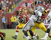 Washington Redskins running back Mack Brown (34) carries the ball in fourth quarter action against the Oakland Raiders at FedEx Field in Landover, Maryland on Sunday, September 24, 2017.  Oakland Raiders outside linebacker Cory James (57) is being blocked by Washington Redskins tight end Vernon Davis (85) on the play. The Redskins won the game 27-10.<br /> Credit: Ron Sachs / CNP