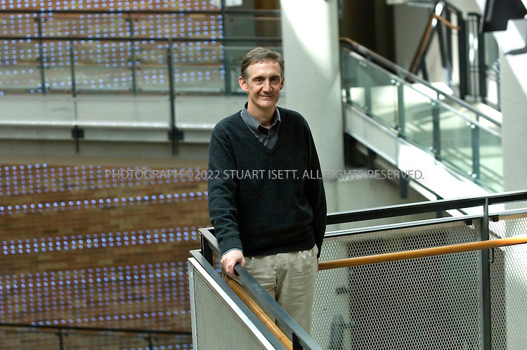 4/6/2007--Seattle WA, USA .Ed Lazowska, a professor of computer science at the University of Washington's Paul G. Allen Center for Computer Science & Engineering, .posing in the main atrium of the center...Photograph ©2007 Stuart Isett.All rights reserved