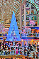 Looking across the decorated atrium at  Christmas shoppers in Toronto's Eaton Centre.