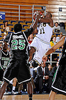 6 February 2010:  FIU's Marvin Roberts (11) shoots over North Texas' Eric Tramiel (25) in the second half as the North Texas Mean Green defeated the FIU Golden Panthers, 68-66, at the U.S. Century Bank Arena in Miami, Florida.
