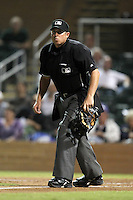 Home plate umpire Tripp Gibson during an Arizona Fall League game between the Salt River Rafters and Peoria Javelinas at HoHoKam Park on November 3, 2011 in Mesa, Arizona.  Salt River defeated Peoria 13-4.  (Mike Janes/Four Seam Images)