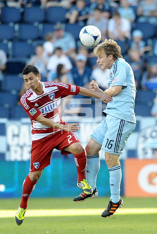 Seth Sinovic (16) Sporting KC defender heads the ball in front of FC Dallas' Bryan Leyva... Sporting KC defeated FC Dallas 2-1 at LIVESTRONG Sporting Park, Kansas City, Kansas.