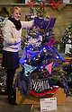04/12/14<br /> <br /> Hannah Nutter, 22, decorates her tree, named 'Pantree', with a pair of knickers.<br /> <br /> The country's largest Christmas tree festival opened last night in Melton Mowbray St Mary's Church, Melton Mowbray, Leicestershire. Visitors can view the 905 trees which range from full size to miniature trees every day until 3pm on Tuesday, when the businesses, clubs and people in the town who made the trees will collect them - many of them being walked through the town to be relocated to new sites for the rest of Christmas.<br /> <br /> All the trees are themed, often with funny names. There's an interactive electronic tree, a money tree (photographed) and many trees are decorated with poppies to commemorate the 100 year anniversary of WW1.  <br /> <br /> Hannah Nutter's tree, named 'Pantree', is decorated with pants and knickers.<br /> <br /> <br /> ***ANY UK EDITORIAL PRINT USE WILL ATTRACT A MINIMUM FEE OF &pound;130. THIS IS STRICTLY A MINIMUM. USUAL SPACE-RATES WILL APPLY TO IMAGES THAT WOULD NORMALLY ATTRACT A HIGHER FEE . PRICE FOR WEB USE WILL BE NEGOTIATED SEPARATELY***<br /> <br /> <br /> All Rights Reserved - F Stop Press. www.fstoppress.com. Tel: +44 (0)1335 300098
