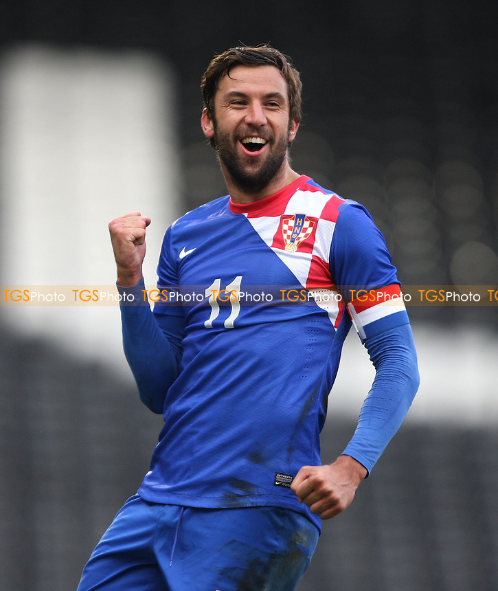 Darijo Srna celebrates after scoring the 2nd goal for Croatia - Croatia vs Korea Republic, International Friendly at Craven Cottage, London - 06/02/13 - MANDATORY CREDIT: Rob Newell/TGSPHOTO - Self billing applies where appropriate - 0845 094 6026 - contact@tgsphoto.co.uk - NO UNPAID USE.