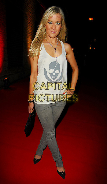 KATE LAWLER.OK! Magazine - private 10th anniversary party, Old Billingsgate, London, UK..May 10th, 2006.Ref: CAN.full length grey gray jeans denim white tank top skull crossbones.www.capitalpictures.com.sales@capitalpictures.com.©Capital Pictures