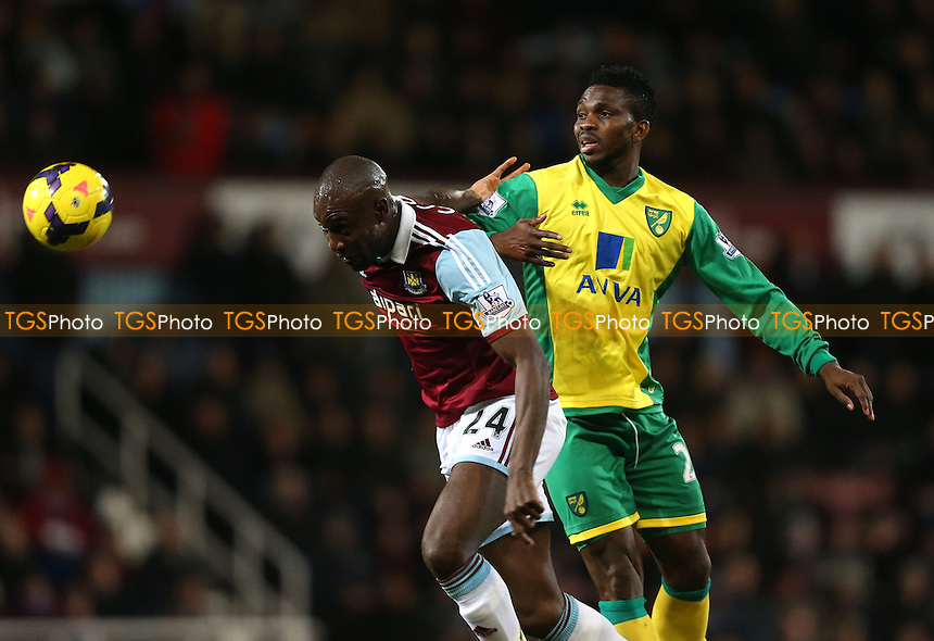 Carlton Cole of West Ham and Joseph Yobo of Norwich - West Ham United vs Norwich City, Barclays Premier League at Upton Park, West Ham - 11/02/14 - MANDATORY CREDIT: Rob Newell/TGSPHOTO - Self billing applies where appropriate - 0845 094 6026 - contact@tgsphoto.co.uk - NO UNPAID USE