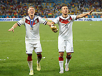 Bastian Schweinsteiger and Lukas Podolski of Germany lifts the World Cup trophy after winning the 2014 final