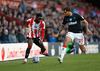 8th February 2020; Griffin Park, London, England; English Championship Football, Brentford FC versus Middlesbrough; Lukas Nmecha of Middlesbrough marking Josh Dasilva of Brentford aloong the wing