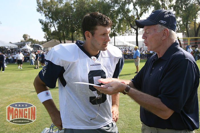 OXNARD - JULY 26:  Owner Jerry Jones of the Dallas Cowboys talks with Cowboys quarterback Tony Romo at training camp in Oxnard, California on July 26, 2008.  Photo by Brad Mangin