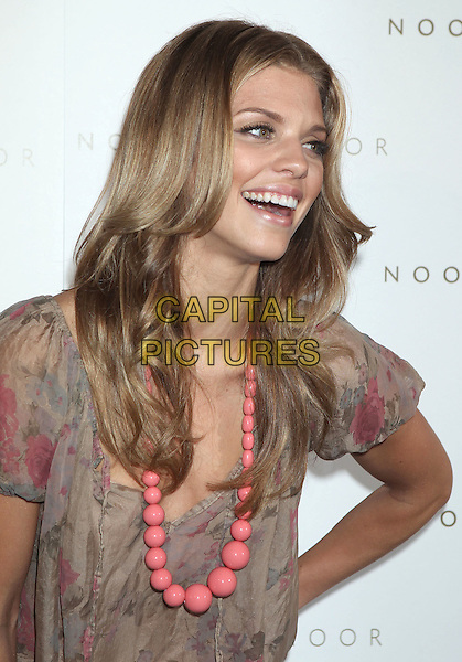 AnnaLynne McCord.'Noon by Noor' Launch Event held at the Sunset Tower Hotel, West Hollywood, California, USA..July 20th, 2011.half length beige pink floral print dress beads necklace smiling.CAP/ADM/RE.©Russ Elliot/AdMedia/Capital Pictures.