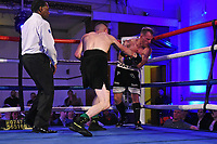 Louis Greene (black shorts) defeats Joe Hayes during a Boxing Show at the Camden Centre on 10th March 2018