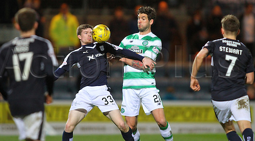 05.04.2016. Dens Park, Dundee, Scotland. Scottish Football Premiership Dundee versus Celtic. Craig Wighton holds off the challenge of Charlie Mulgrew . The game ended in a dull 0-0 draw.