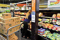 MIRAMAR, FL - OCTOBER 06: view of employee stocking the shelve inside Walmart in Miramar, Florida in preparation for the landfall of Hurricane Matthew on October 6, 2016 in Miramar, Florida. The hurricane is expected to make landfall sometime this evening or early in the morning as a possible category 4 storm.Credit: MPI10 / MediaPunch