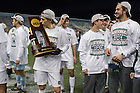 Dec 15, 2013; Players take turns holding the College Cup championship trophy after defeating Maryland 2-1 in Chester, Pa. Photo by Barbara Johnston/University of Notre Dame