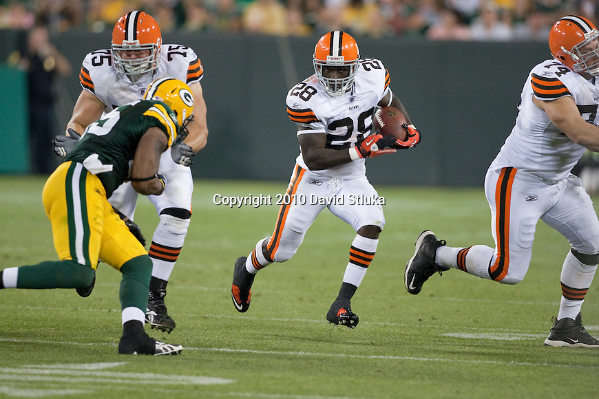 Cleveland Browns running back James Davis (28) carries the ball during an NFL preseason football game against the Green Bay Packers in Green Bay, Wisconsin on August 14, 2010. The Browns won 27-24. (AP Photo/David Stluka)