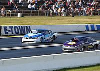 Jun 6, 2015; Englishtown, NJ, USA; NHRA pro stock driver Alan Prusiensky (left) alongside Vincent Nobile during qualifying for the Summernationals at Old Bridge Township Raceway Park. Mandatory Credit: Mark J. Rebilas-
