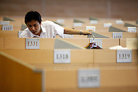 Stock trader work on the trading floor of the Shanghai Stock Exchange (SSE) in Shanghai, China. The Shanghai Stock Exchange is one of the three stock exchanges operating independently in the People's Republic of China, the other two are the Shenzhen Stock Exchange and the Hong Kong Stock Exchange. It is the world's sixth largest stock market by market capitalization at US$2.4 trillion as of Aug 2010..18 Aug 2010.