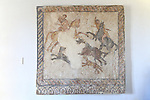 Wall mounted Roman mosaic hunting scene in museum, Caceres, Extremadura, Spain