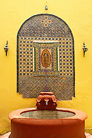 Fountain in a Spanish colonial house, San Miguel de Allende, Mexico. San Miguel de Allende is a UNESCO World Heritage Site....
