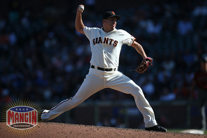 SAN FRANCISCO, CA - SEPTEMBER 17:  Derek Law #64 of the San Francisco Giants pitches against the Arizona Diamondbacks during the game at AT&T Park on Sunday, September 17, 2017 in San Francisco, California. (Photo by Brad Mangin)