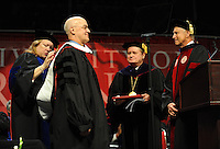 NWA Media/ANDY SHUPE - Andrew Hamilton, vice chancellor of the University of Oxford, center, waits as Sharon Gaber, provost and vice chancellor for academic affairs at the University of Arkansas, left; David Gearhart, chancellor of the university; and Jim von Gremp, chairman of the university's Board of Trustees, right, bestow upon him an honorary degree during fall commencement exercises Saturday, Dec. 20, 2014, at Barnhill Arena on the university campus in Fayetteville.