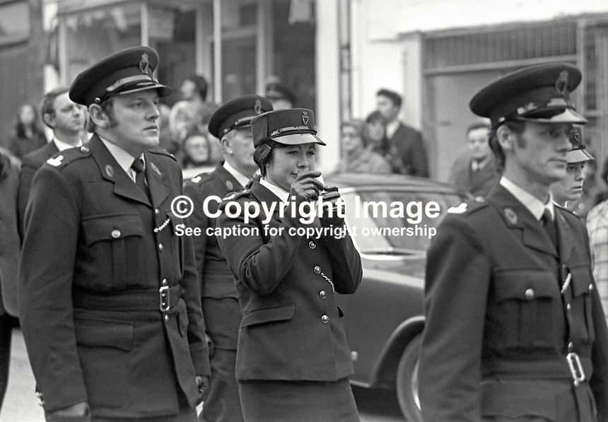 Funeral cortege of Sergeant George Coulter, RUC, makes it way from St Anne's Church of Ireland, Dungannon, N Ireland. The tearful policewoman is Reserve Constable Carole Malcolmson, 20 years, whose life Sergeant Coulter saved by deliberately shielding her in the back of the patrol car from automatic fire by two Provisional IRA gunmen. The patrol car was ambushed as it reached a road junction near the village of Donaghmore after it had been checking the home of a Nationalist MP who was under police guard. 197502030062a<br /> <br /> Copyright Image from Victor Patterson, 54 Dorchester Park, Belfast, UK, BT9 6RJ<br /> <br /> t1: +44 28 9066 1296 (from Rep of Ireland 048 9066 1296)<br /> t2: +44 28 9002 2446 (from Rep of Ireland 048 9002 2446)<br /> m: +44 7802 353836<br /> <br /> e1: victorpatterson@me.com<br /> e2: victorpatterson@gmail.com<br /> <br /> The use of my copyright images is subject to my Terms &amp; Conditions.<br /> <br /> It is IMPORTANT that you familiarise yourself with them. They are available on my website at www.victorpatterson.com.<br /> <br /> None of my copyright images may be used on a website unless they are visibly watermarked, i.e. &copy; Victor Patterson within the body of the visible image. Metadata denoting my copyright must NOT be deleted. <br /> <br /> Web use is extra at currently recommended NUJ rates.