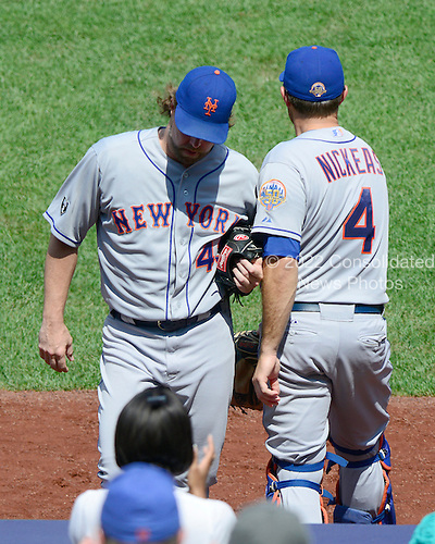 New York Mets pitcher R.A. Dickey (43) is congratulated by Mike Nickeas (4) as he leaves the game in the eighth inning against the Washington Nationals at Nationals Park in Washington, D.C. on Thursday, July 19, 2012.  The Mets won the game 9 - 5..Credit: Ron Sachs / CNP.(RESTRICTION: NO New York or New Jersey Newspapers or newspapers within a 75 mile radius of New York City)