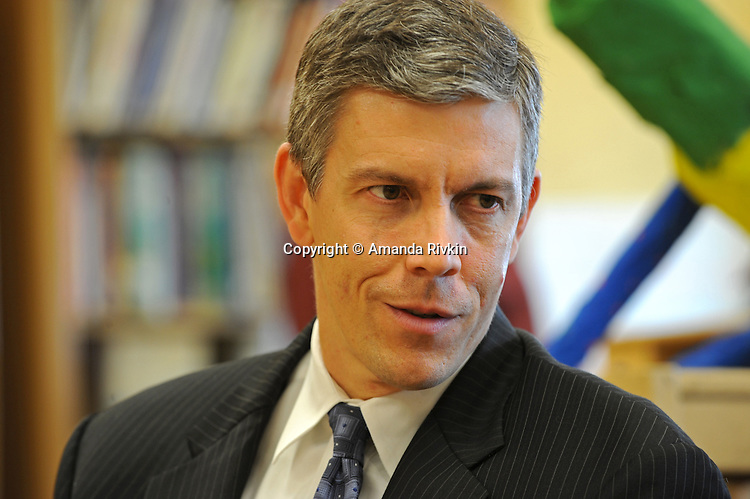 "Arne Duncan, the Chief Executive Officer of the Chicago Public Schools, CPS, listens to a colleague before a press conference for Mayor Daley's ""Principal for a Day"" program of corporate sponsorship and volunteerism in the Chicago Public Schools at Talcott Elementary School, 1840 W. Ohio St., in Chicago, Illinois on October 17, 2008."