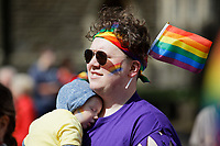 Pictured: A man carries his sleeping baby in the parade. Saturday 04 May 2019<br /> Re: Swansea Pride Parade in south Wales, UK.