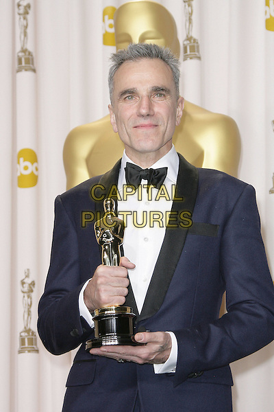Daniel Day Lewis  .85th Annual Academy Awards held at the Dolby Theatre at Hollywood & Highland Center, Hollywood, California, USA..February 24th, 2013.pressroom oscars half length black blue tuxedo white shirt award winner trophy .CAP/ADM.©AdMedia/Capital Pictures.
