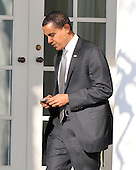 Washington, DC - January 29, 2009 -- United States President Barack Obama works with his Blackberry as he returns to the Oval Office at the White House in Washington, D.C. after going to Sidwell Friends School in Bethesda, Maryland for a class presentation for his his daughter Sasha on Thursday, January 29, 2009..Credit: Ron Sachs - Pool via CNP