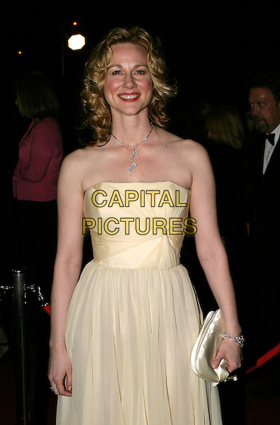 LAURA LINNEY.Bafta Awards - British Academy Awards.15 February 2004.half length, half-length, strapless yellow dress.www.capitalpictures.com.sales@capitalpictures.com.© Capital Pictures.