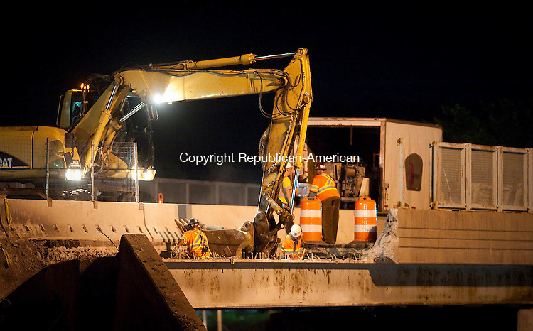 WATERBURY, CT--- -071015JS11-- Workers prepare to remove the deck and parapet of the Hamilton Avenue Bridge over Interstate 84 west-bound in Waterbury on Friday. The work is part of the I-84 reconstruction project. <br /> Jim Shannon Republican-American