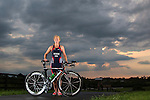 A portrait of Mary Henson with her tri bike on September 2, 2014, in Versailles, Ky.  Henson, 59, will represent Team USA in the 2014 ITU Long Course Triathlete World Championship in Weihai, China on September 21, 2014.  The course will consist of a 2.4 mile swim, 74 mile bike, and 12.4 run.  Photo by Mark Mahan