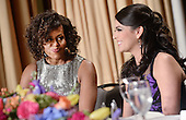 Saturday Night Live's comedian Cecily Strong, right, speaks with first lady Michelle Obama at the annual White House Correspondent's Association Gala at the Washington Hilton hotel April 25, 2015 in Washington, D.C. The dinner is an annual event attended by journalists, politicians and celebrities.<br /> Credit: Olivier Douliery / Pool via CNP
