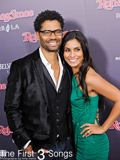 Singer Eric Benet with girlfriend Manuela Testolini attend the 2010 American Music Awards VIP After Party hosted by Rolling Stone Magazine at the Rolling Stone Restaurant & Lounge in Los Angeles, California.