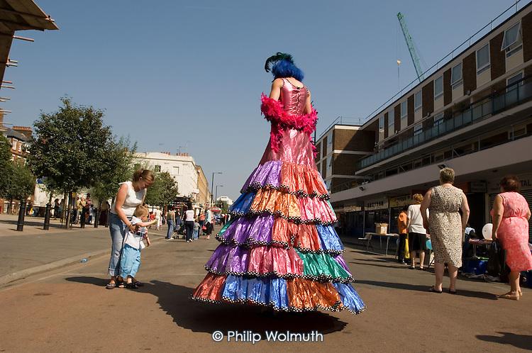 A stilt walker at Church Street Summer Festival 2005, Paddington, London.