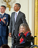 United States President Barack Obama presents the National Humanities Medal to Fedwa Malti-Douglas of Rhinebeck, New York, professor and scholar, during a ceremony in the East Room of the White House in Washington, DC on Thursday, September 10, 2015.<br /> Credit: Ron Sachs / CNP<br /> (RESTRICTION: NO New York or New Jersey Newspapers or newspapers within a 75 mile radius of New York City)