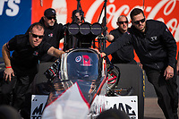 Feb 2, 2017; Chandler, AZ, USA; Crew members push the car of NHRA top fuel driver Steve Torrence during Nitro Spring Training preseason testing at Wild Horse Pass Motorsports Park. Mandatory Credit: Mark J. Rebilas-USA TODAY Sports
