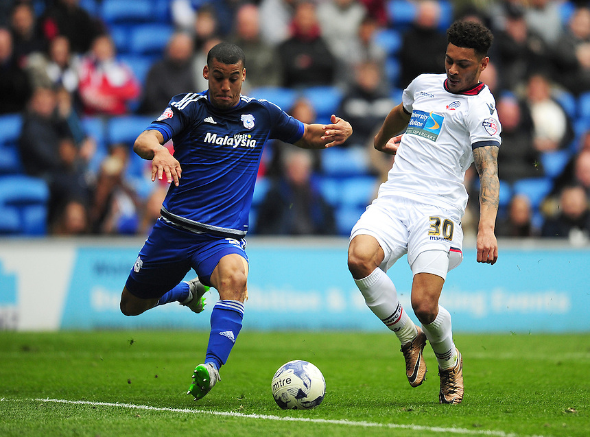 Bolton Wanderers' Kaiyne Woolery under pressure from Cardiff City's Lee Peltier<br /> <br /> Photographer Kevin Barnes/CameraSport<br /> <br /> Football - The Football League Sky Bet Championship - Cardiff City v Bolton Wanderers - Saturday 23rd April 2016 - Cardiff City Stadium - Cardiff <br /> <br /> &copy; CameraSport - 43 Linden Ave. Countesthorpe. Leicester. England. LE8 5PG - Tel: +44 (0) 116 277 4147 - admin@camerasport.com - www.camerasport.com