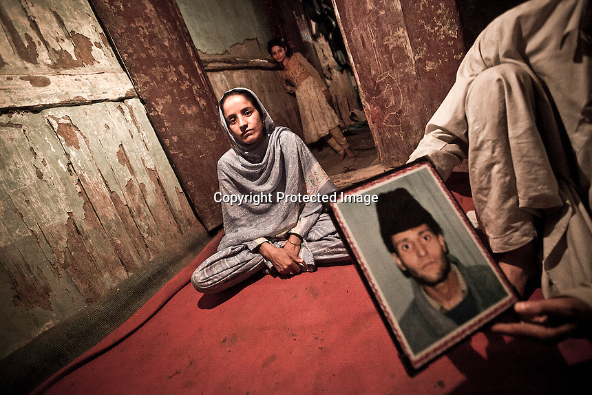 "Naseeme is a half widow on her 30's, Shazai her daugther (at the bottom) barely is 10. On 21t July 2002, Sayed Anwar, Naseeme's husband, at 8 o'clock morning left and never went back. He was picked up by paramilitary forces. Naseeme says: ""I'm afraid to get married again though I'm young, if I shall do my daughter will become spoiled, but I wait for my husband to come back"". Srinagar, Indian administrated Kashmir."