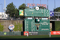 July 15, 2009: Players get loose prior to the start of the 2009 Triple-A All-Star game at PGE Park in Portland, Oregon, while fans filter into the stadium.  A unique stadium, PGE Park has a walkway and one row of seats that span from left to center field.  Its manual scoreboard is nearly seven stories tall.