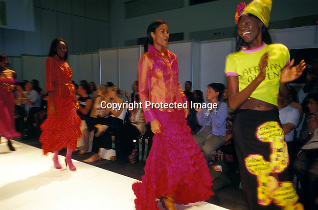 Catwalk,runway,models,audience,convention centre,african,colorful.A fashion show during the annual design Indaba in Cape Town,SA. The show showcases S. African design, fashion etc. The black design label Afro Divas by Hip-Hop showcased their African fashion..©Per-Anders Pettersson/iAfrika Photos