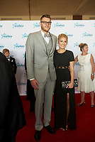 "ST. PAUL, MN JULY 16: Minnesota Timberwolves player Cole Aldrich poses on the red carpet at the Starkey Hearing Foundation ""So The World May Hear Awards Gala"" on July 16, 2017 in St. Paul, Minnesota. Credit: Tony Nelson/Mediapunch"