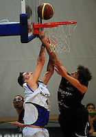 Action from the National Basketball Championships tournament fifth-place playoff match between Auckland (white) and North Harbour (black) at Te Rauparaha Arena, Wellington, New Zealand on Saturday, 15 November 2014. Photo: Dave Lintott / lintottphoto.co.nz